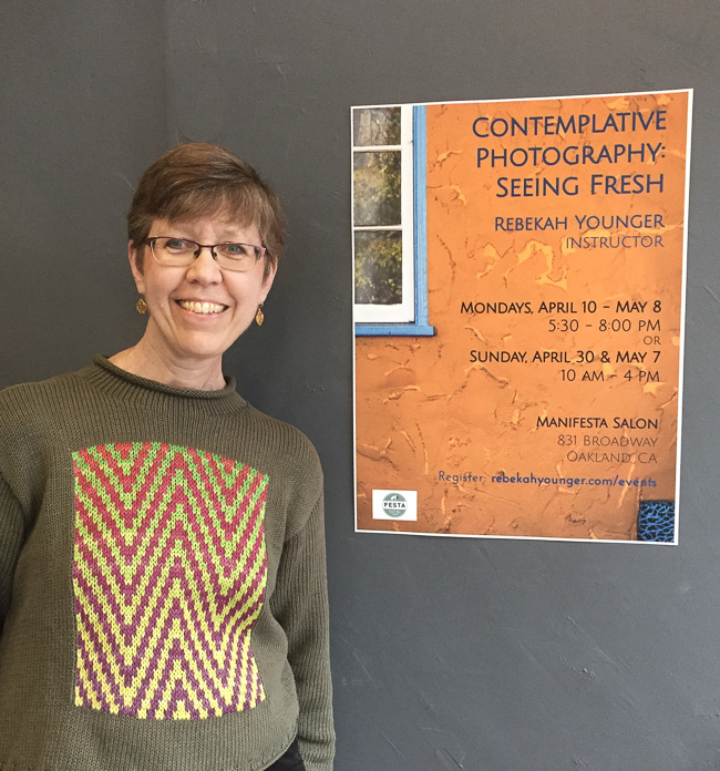 Rebekah shown with the poster for her upcoming classes in Contemplative Photography in Oakland